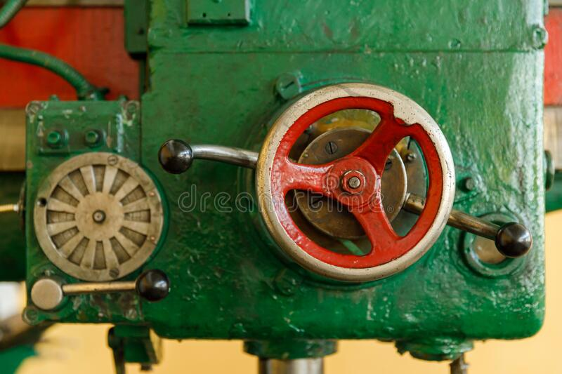 Red controls of the Universal old and green Milling Machine royalty free stock photos