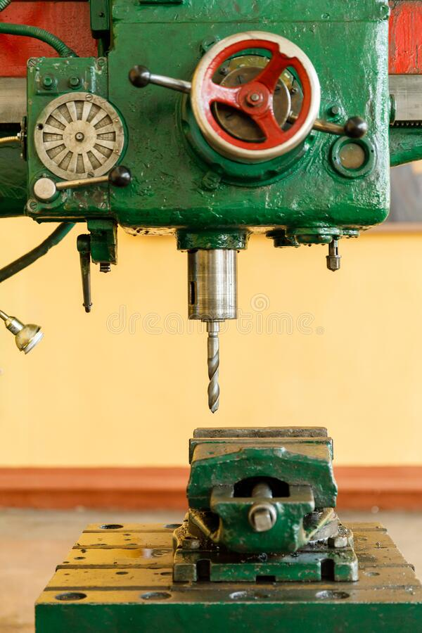 Red controls of the Universal old and green Milling Machine royalty free stock photo