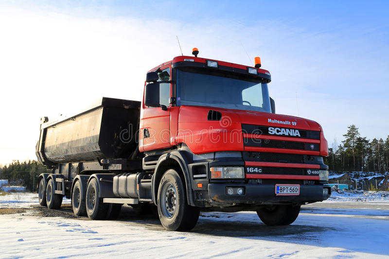 Red Conventional Cab Scania 164C Truck. NAANTALI, FINLAND - FEBRUARY 15, 2015: Scania 164C 480 truck for construction. The 164C is a Scania 4-series truck with stock images