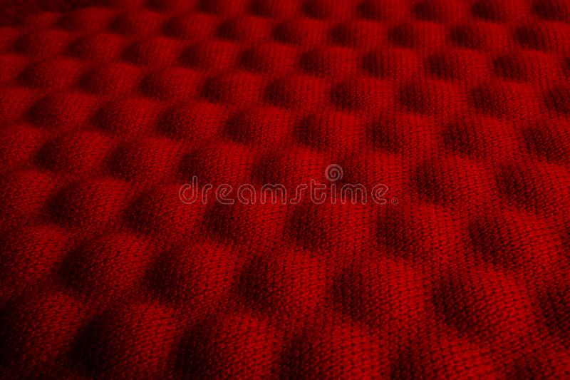 Red convex nylon fabric pattern texture. royalty free stock images
