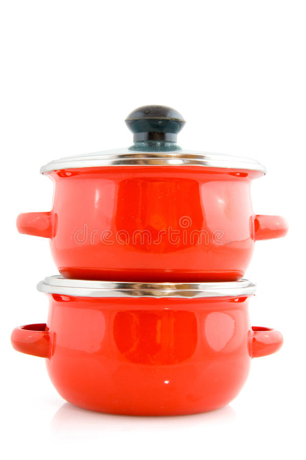 Red cooking pots. Stacked red cooking pots isolated over white royalty free stock photo