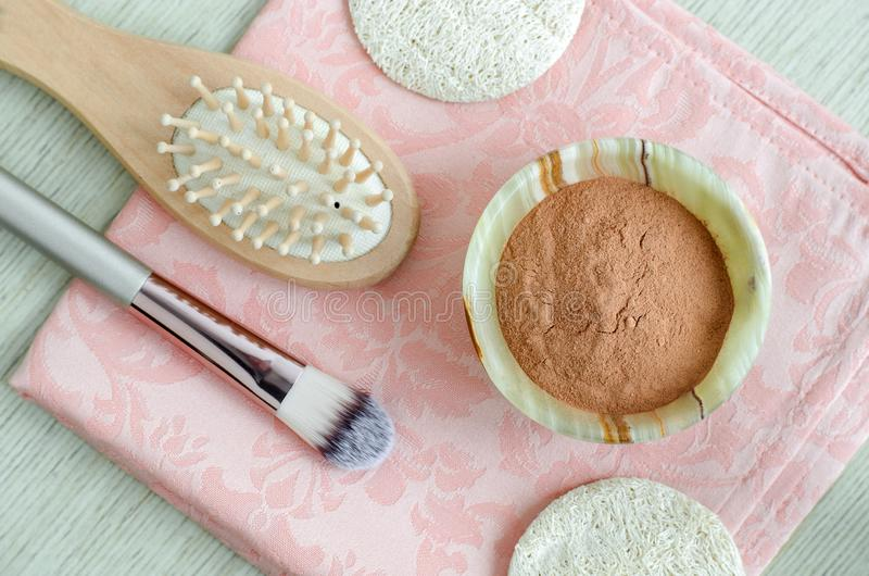 Red cosmetic clay powder in the small onyx bowl. Homemade beauty mask for skin and hair. Top view stock images