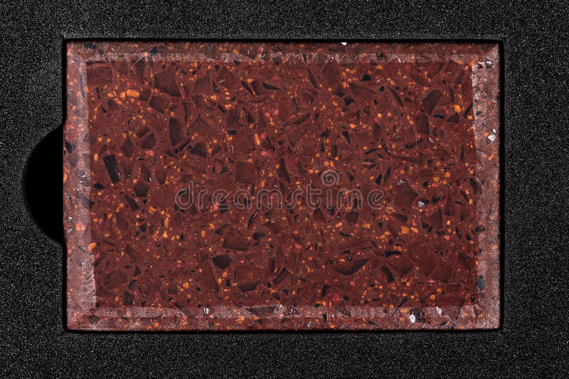 Red counter top sample. Counter top red stone sample on black background stock image