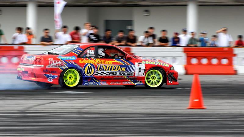 Red coupe drifting during Formula Drift Singapore. Hong Kong driver competing during Formula Drift Singapore 2009 Pro-Am Series at Singapore Changi Exhibition royalty free stock photo