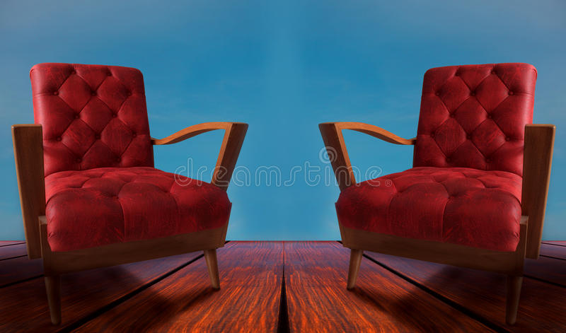 Red couples arm chairs on wood and blue background. Image of red couples arm chairs on wood and blue background stock photography