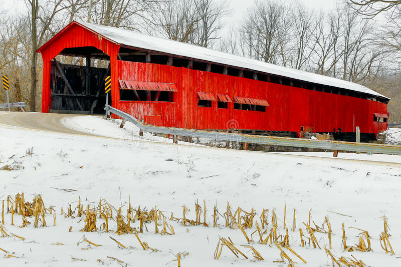 Red Covered Bridge Midwinter. The red Dunbar Covered Bridge is surrounded by winter snow near Greencastle in Putnam County, Indiana stock photos