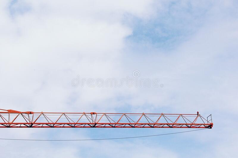 Red Crane Photo Under Cloudy Sky during Daytime royalty free stock photo