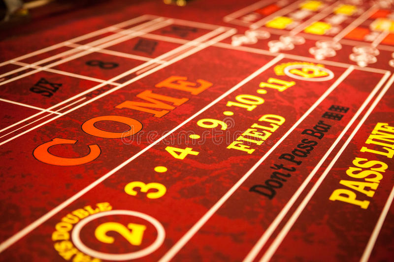 Red Craps Table in casino. Red Craps Table from angle stock photo