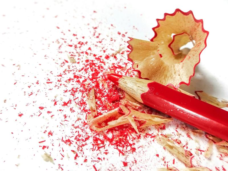 Red crayon pencil with shavings on white background. stock photos