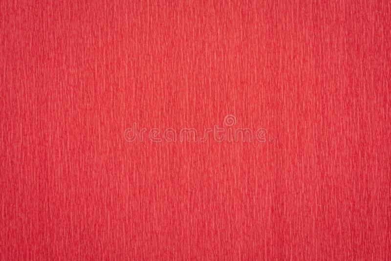 Red crepe paper background. Red crepe paper - background with crinkled texture royalty free stock image