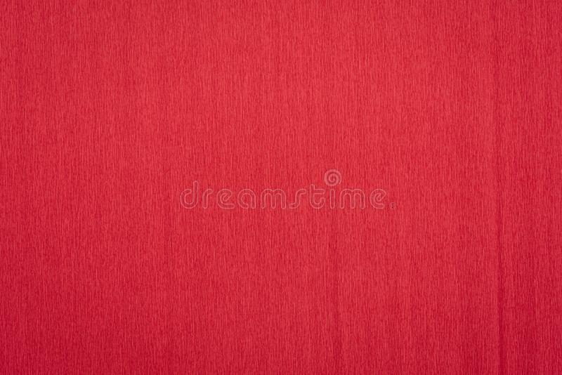 Red crepe paper background. Red crepe paper - background with crinkled texture stock photo