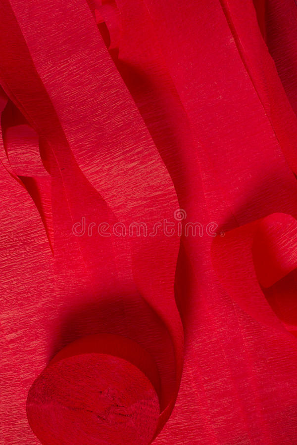 Red Crepe paper streamers. This is a photograph of Red Crepe paper streamers stock photo