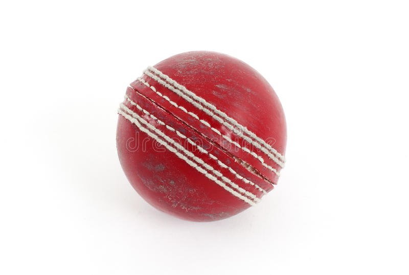 Red Cricket Ball. A red cricket ball isolated against a white background royalty free stock photos