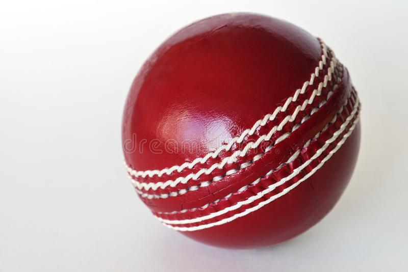 Red cricket leather ball royalty free stock photo