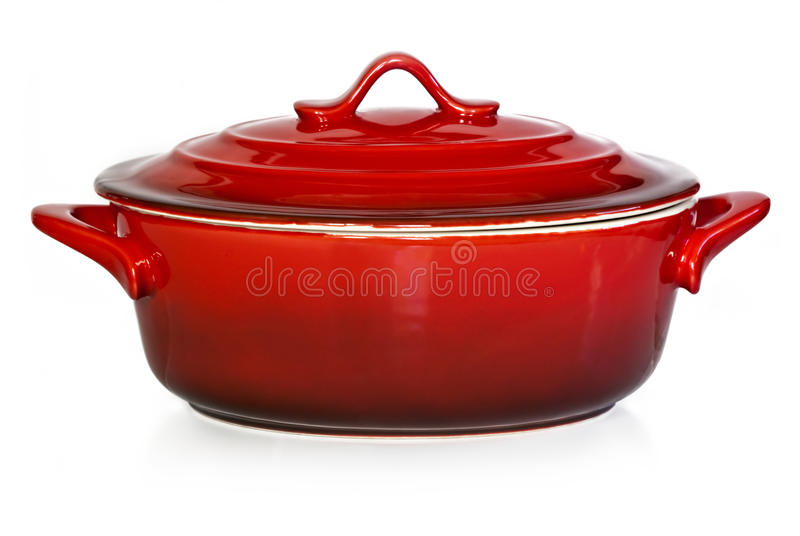 Red Crock Pot. Red casserole dish or crock pot, isolated on white stock image