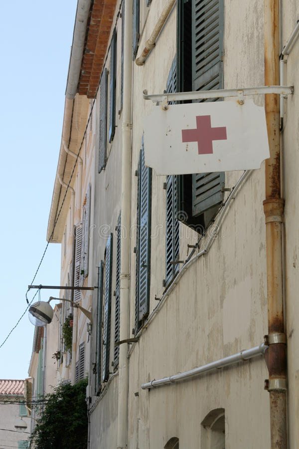 Red cross flag in Antibes, France stock photos