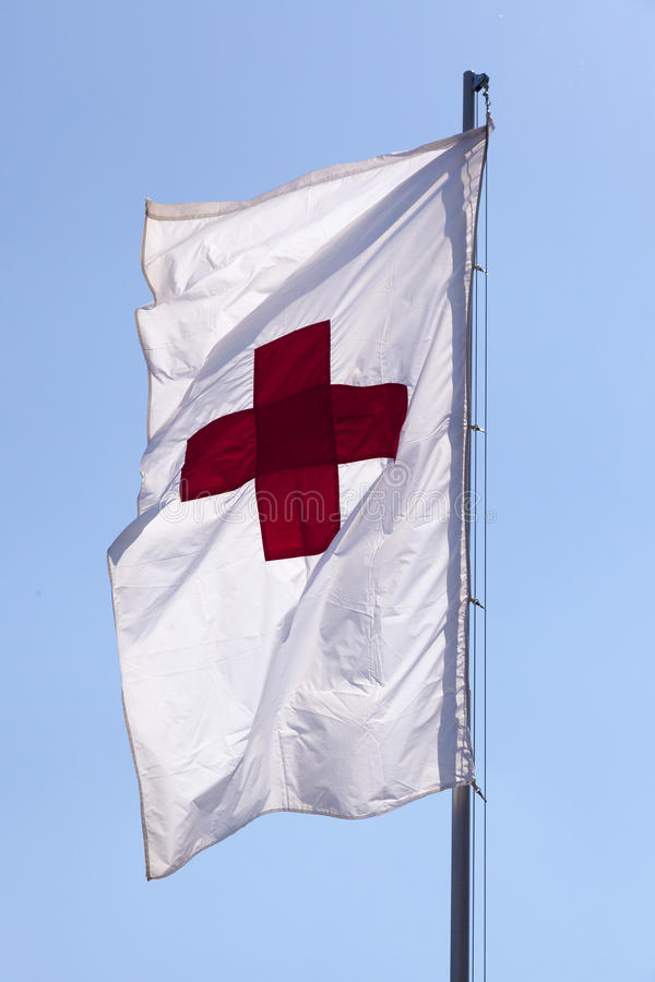 Red cross. International Red cross flag on the pole royalty free stock photos