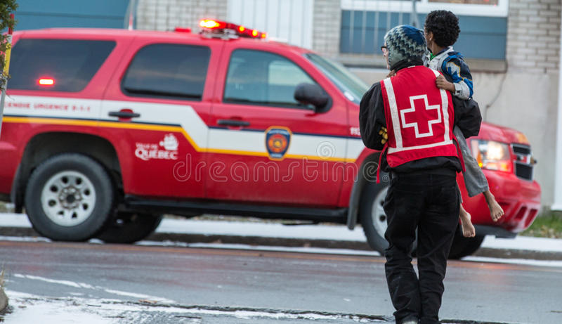 Red cross volunteer help kid after firehouse royalty free stock photo