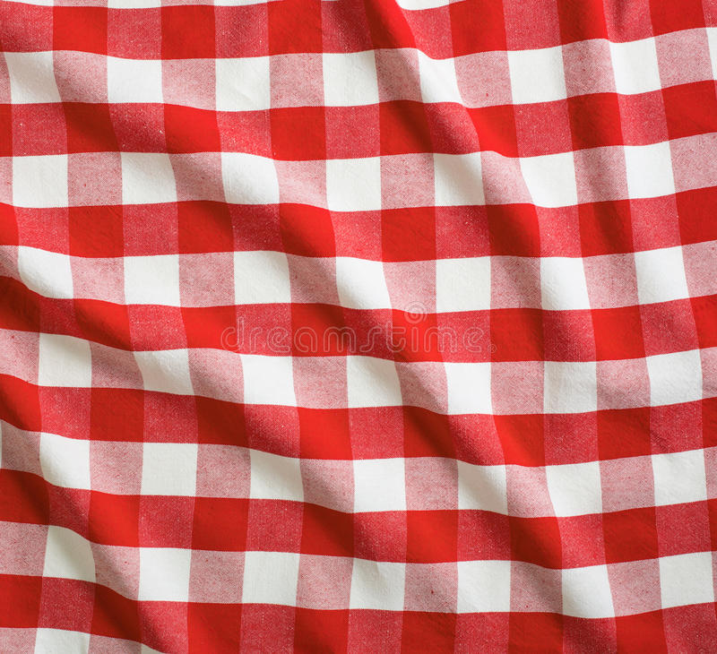 Red crumpled linen gingham picnic tablecloth. Red and white crumpled linen gingham picnic tablecloth stock image