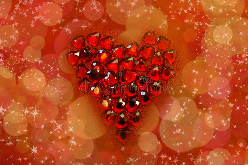Red crystal hearts with a heart form on red glitter background. St. Valentine`s day greetings postcard. Lover`s day. Love. Red crystal hearts with a heart form stock photo