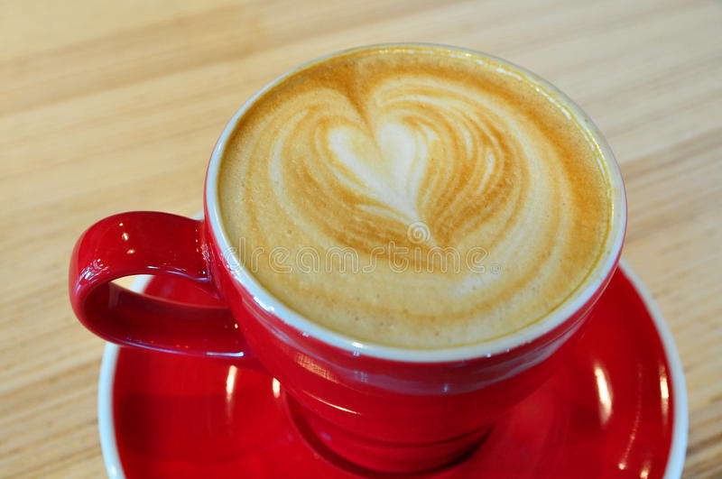 A red cup of hot coffee royalty free stock photos