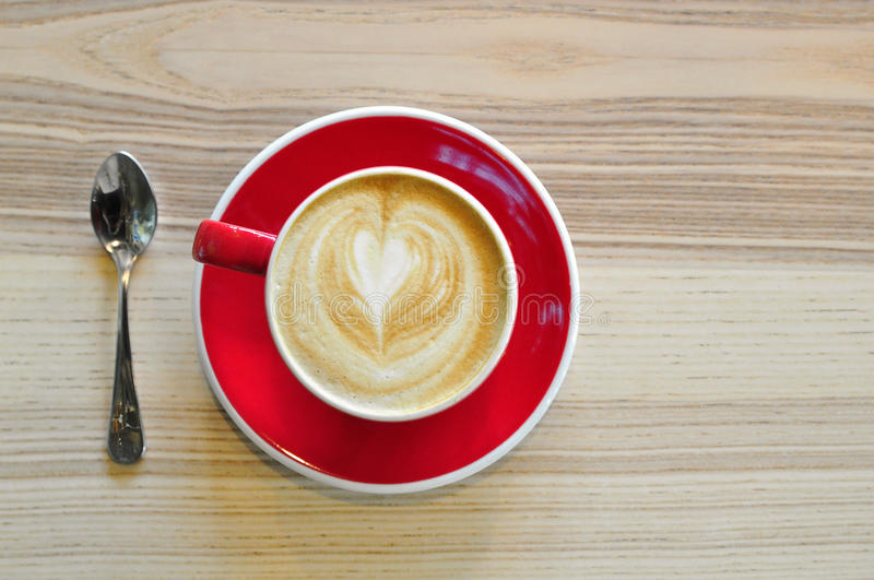 A red cup of hot coffee royalty free stock photo