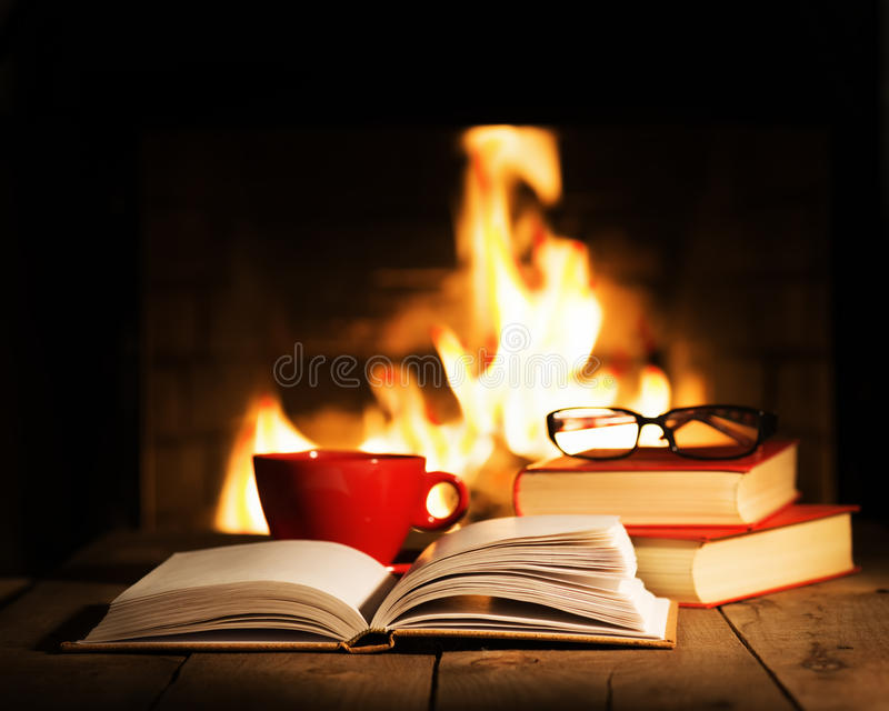 https://thumbs.dreamstime.com/b/red-cup-old-books-wooden-table-near-fireplace-coffee-tea-glasses-winter-christmas-holiday-concept-70371840.jpg