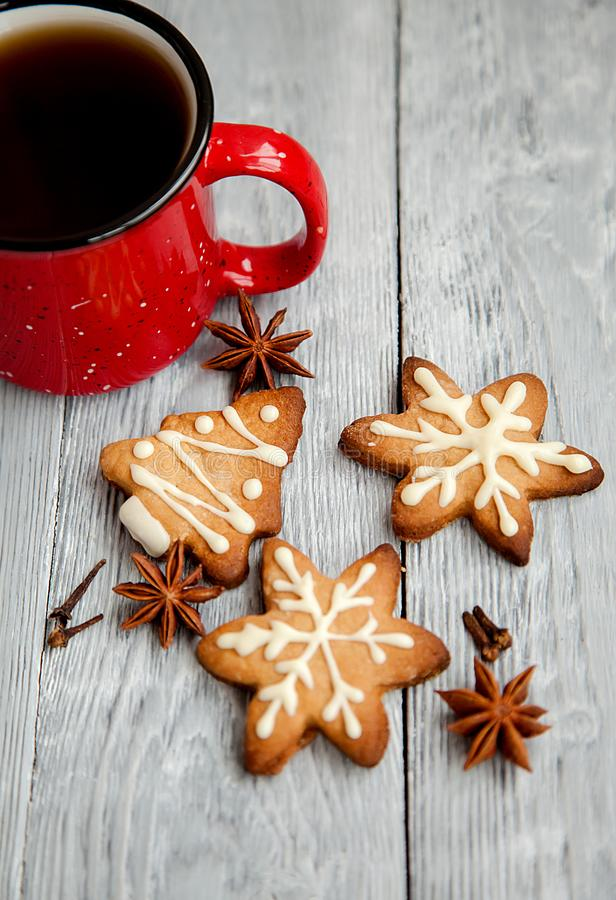 Cup of tea and Christmas cookies on the wooden background stock photography