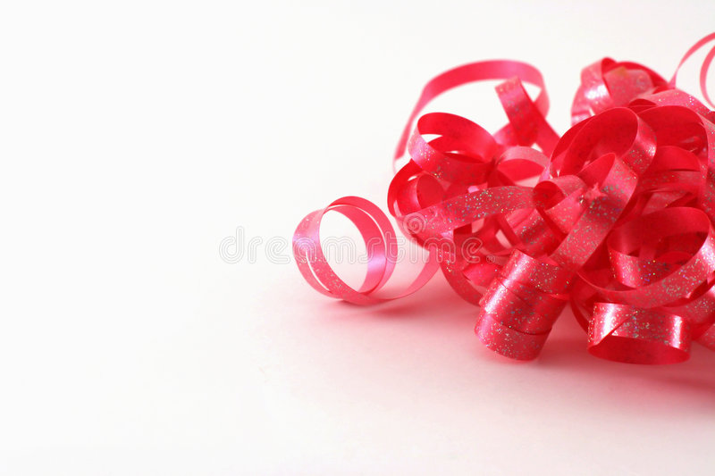 Red curly ribbon stock image