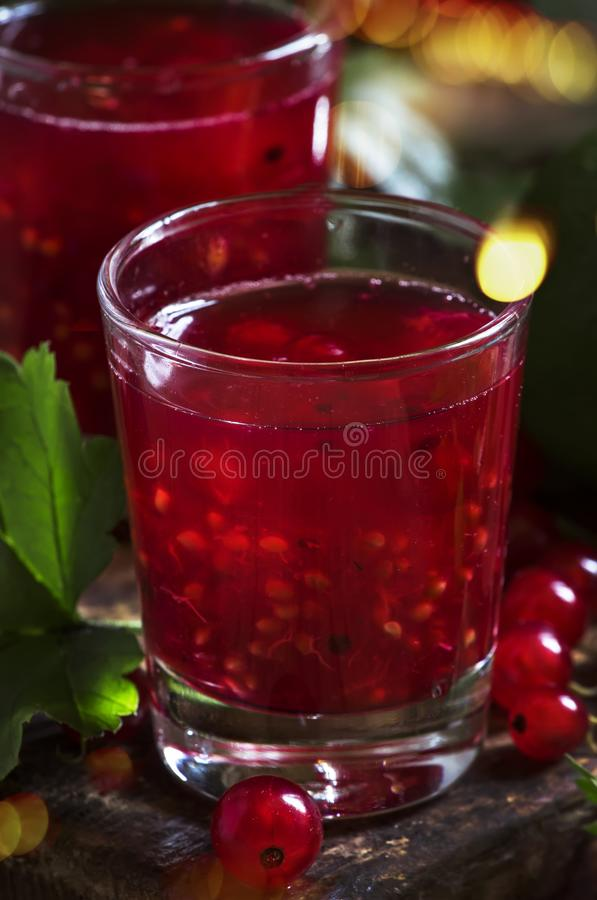 Red currant cocktail with juice, vodka and lime on dark table, top view stock images