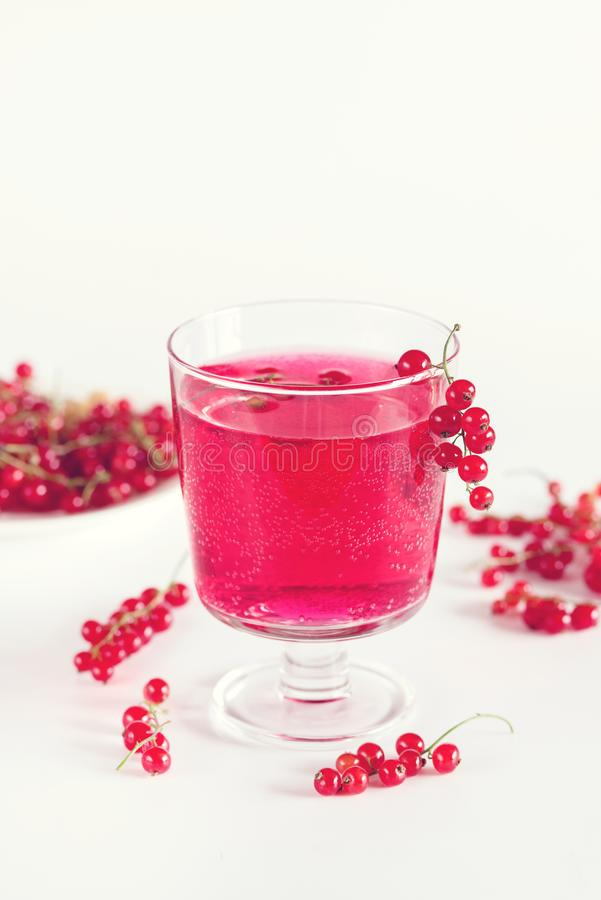 Red Currant Drink in Glass Summer Beverage Tasty Summer Drink White Backgriund Detox Infused Water Toned stock images