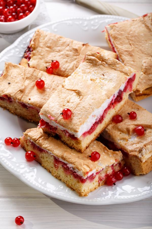 Red currant fruit pie bars with meringue on top stock images