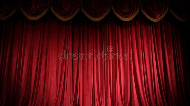 Red curtain. Brightly lit curtains for your background stock photo