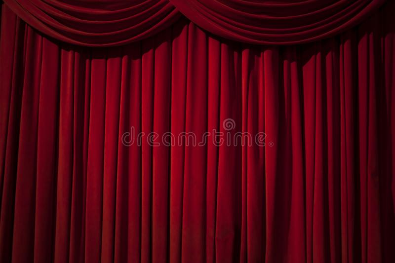 Red curtain stage. Large red curtain stage, with spot lights and dark background royalty free stock photos