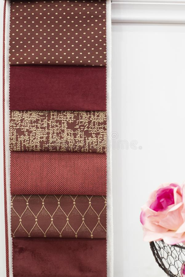 Red curtains fabric pattern palette texture samples as abstract textile background. Handmade, clothes and furniture decoration stock image