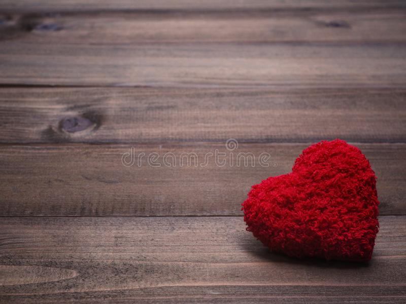 Red cushion heart shape on wood background royalty free stock image