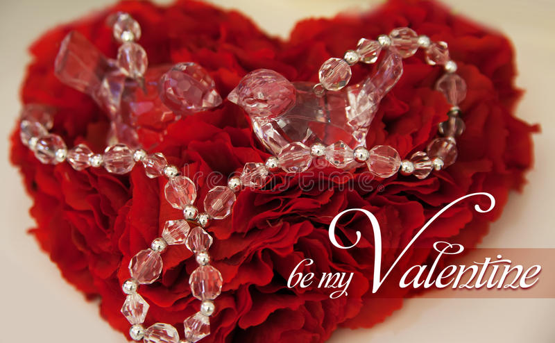 Red cushion for rings with precious stones in the shape of a heart valentines day love. Red cushion for rings with precious stones in the shape of a heart royalty free stock image