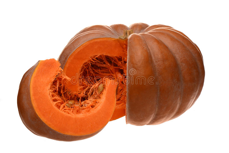 Red cut pumpkin with pulp royalty free stock photo