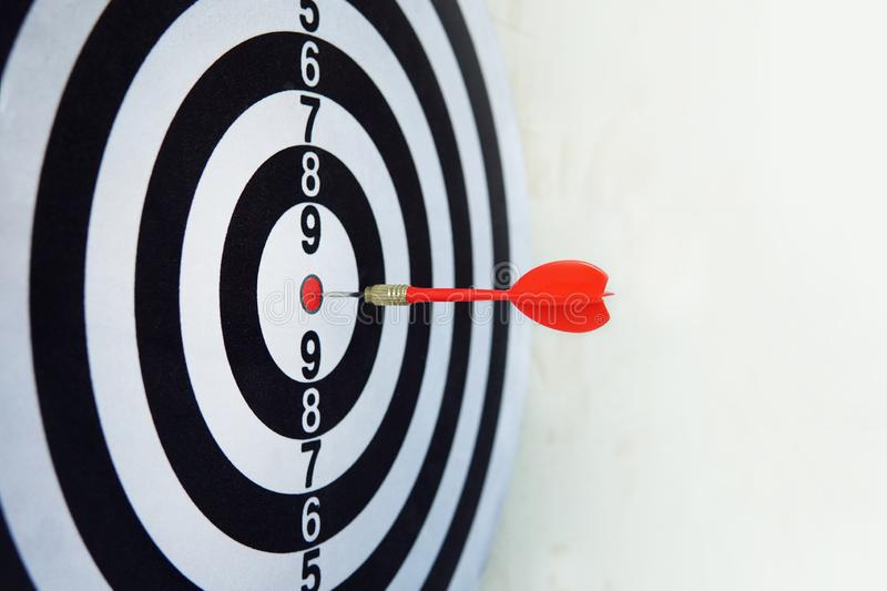 Red dart on board right direction hit target goal. Competition game to win focus on achievement with smart thinking planning stock photo