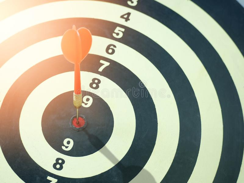 Red dart target arrow hitting on bullseye which is the ultimate goal that everyone wants, Target marketing and business success stock images