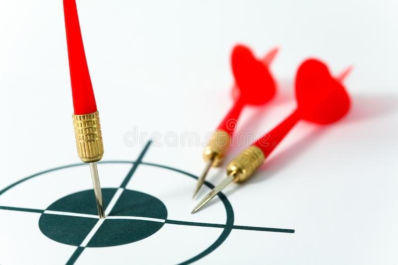 Red darts and target stock image