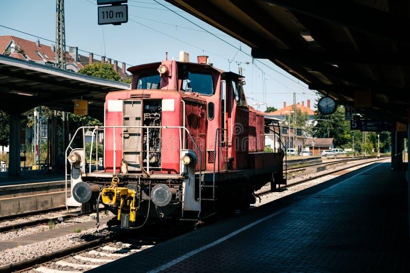 Red DB shunting locomotive in Mullheim railway station. Mullheim, Baden-Wurttemberg, Germany - JULY 30 2018 : Red shunting diesel locomotive without cars in the stock image