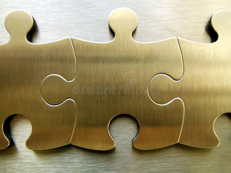Red de oro de los rompecabezas foto de archivo libre de regalías