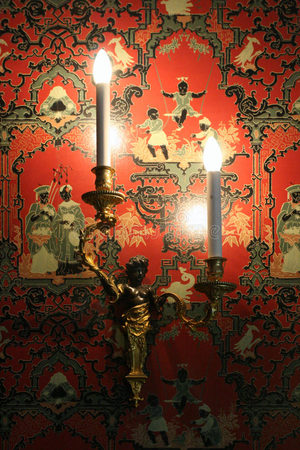 A red and decorated with chinese characters wallpaper decorates one of the rooms of Sully-sur-Loire castle (France). A red and decorated with chinese characters stock photo