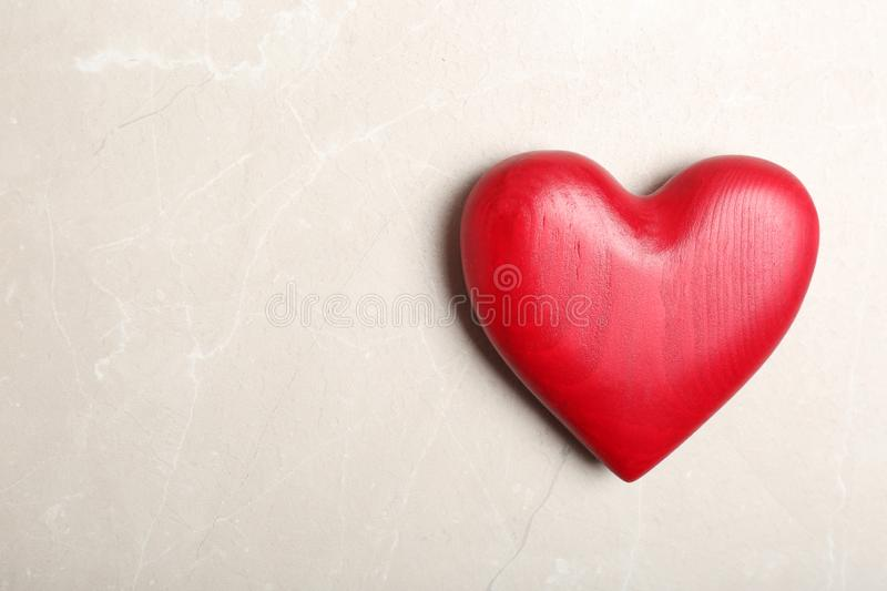 Red decorative heart as symbol of love on color background, top view. With space for text royalty free stock photos