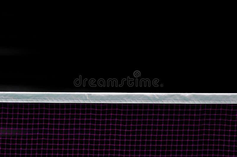 Red del bádminton interior en la corte de bádminton, opinión del primer de la red del bádminton con el fondo negro foto de archivo