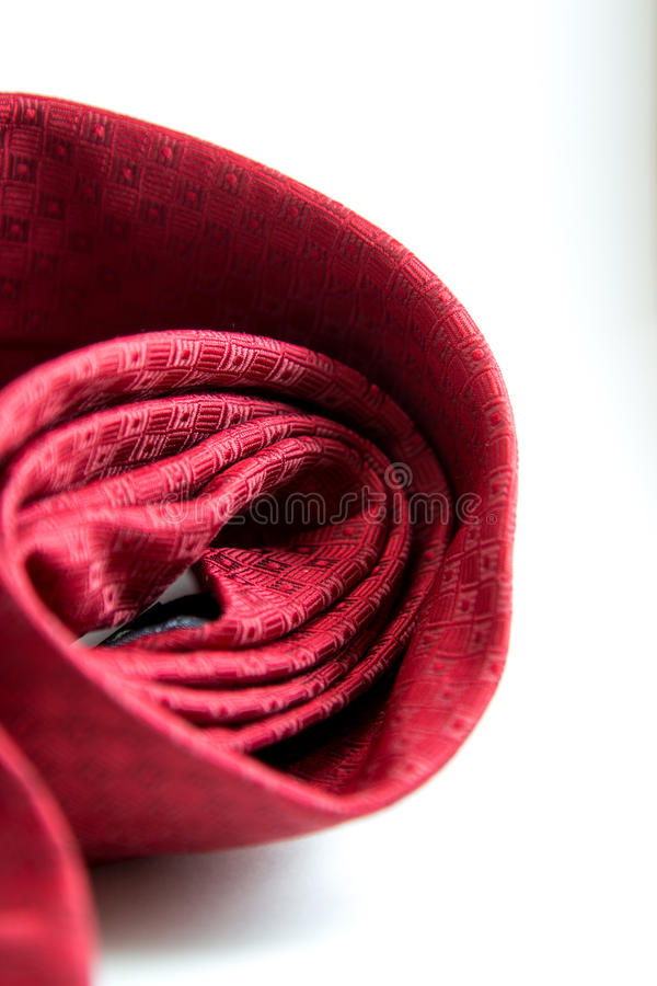 Red design necktie rolled with white background. royalty free stock photo