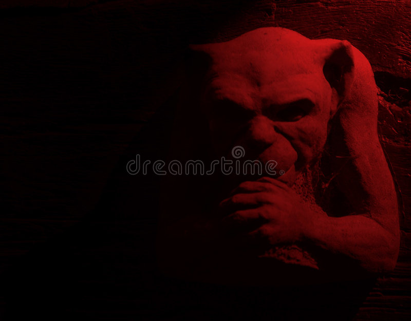 Red devil. Devil figure with red lighting effect royalty free stock images