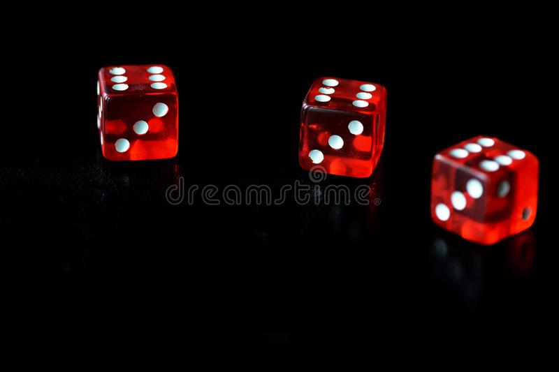 Red dice on a black background close-up. Gambling сoncept royalty free stock photography