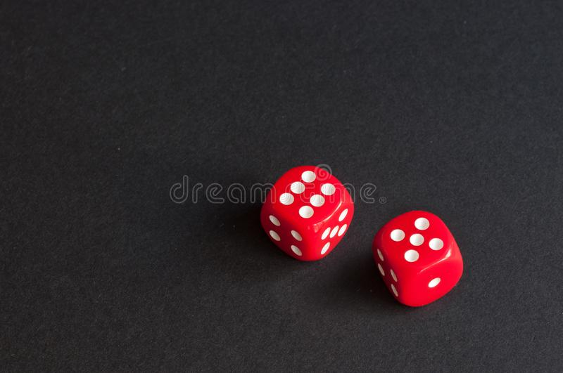 Red dice on black background. place for inscription stock photos